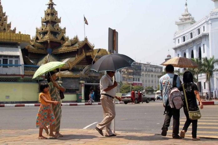 Myanmar citizen pedestrian Yangon downtown Sule