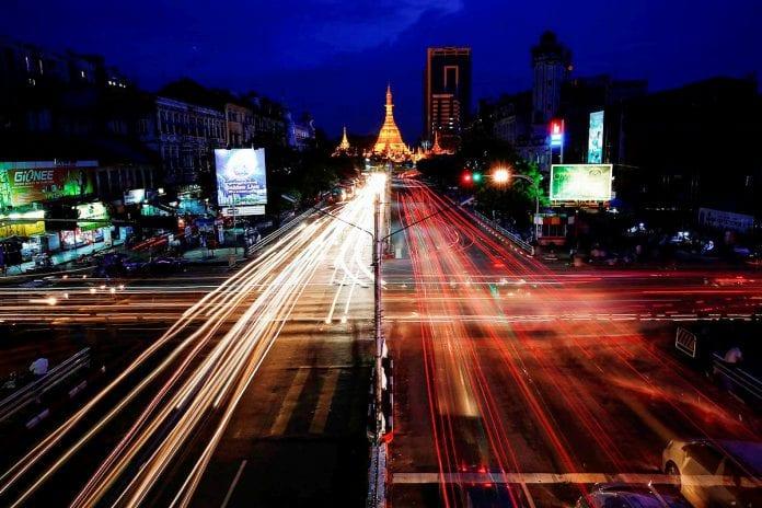 Sule pagoda downtown electricity cars Damir Sagolj Reu