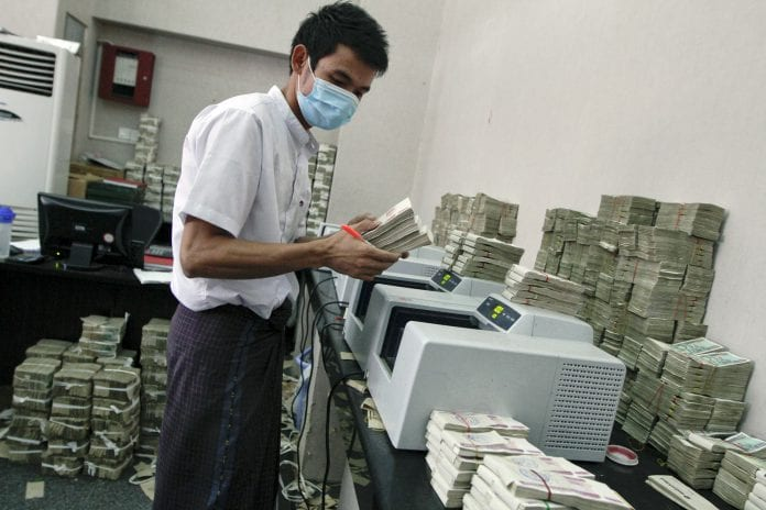 Myanmar kyat dollar bureau bank kbz credit loan interest economy investment (2)