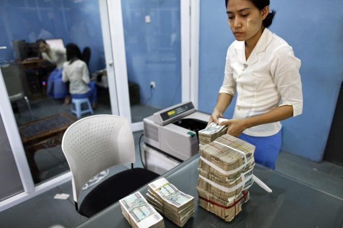 Myanmar kyat dollar bureau bank kbz credit loan interest economy investment (1)