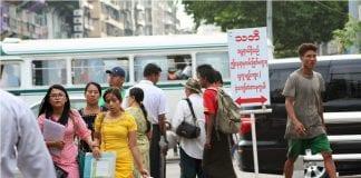 yangon street pedestrian road car traffic economy investment