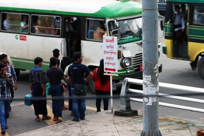 bus woman yangon traffic economy