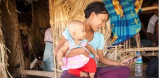 rural photo village woman mobile myanmar Ole Stobbe