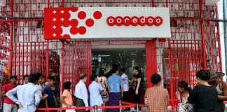 Ooredoo telecoms sim card IT phone mobile