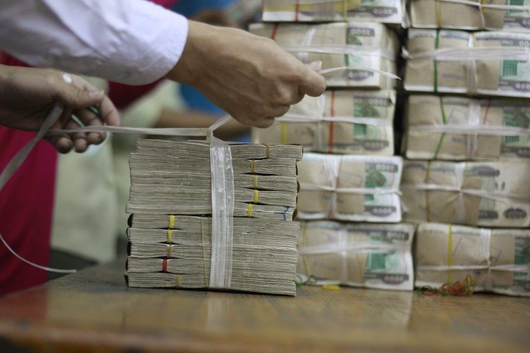 Kyat Myanmar economy bank dollar money tax investment finance inflation