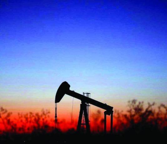 An oil pump is seen just after sunset outside Saint-Fiacre, near Paris, France, September 17, 2019.