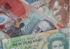 The Australian dollar marked time while its New Zealand cousin suffered from a steep drop in the prices of dairy, the country's top export.
