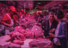 Buyers and sellers at a pork wholesale market in Beijing.
