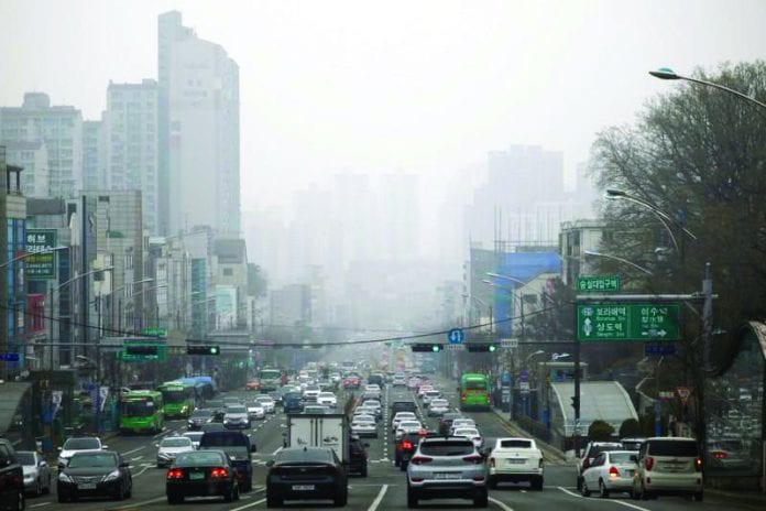 Vehicles move on a road on a polluted day in Seoul, South Korea, March 12, 2019.