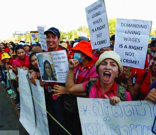 Cambodian workers hold up placards as they gather during a protest for higher pay and better working conditions in front of the NagaWorld hotel and casino complex in Phnom Penh, Cambodia, January 9, 2020.