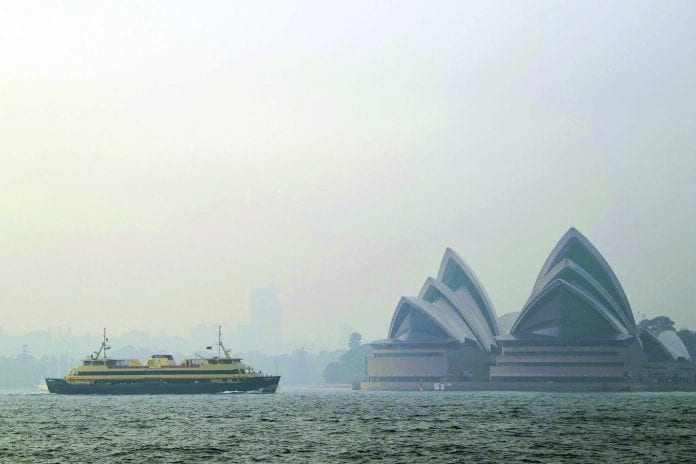Smoke from bush fires has reduced the visibility in Sydney Harbor.